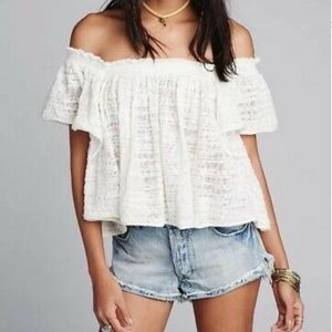 Free People top is off white. Size small